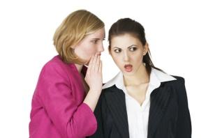 Office girls sharing secret shocked expression